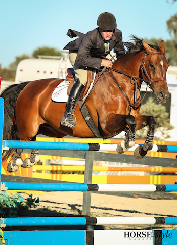 Kelly McKnight guides Zan Chin out of the grob combination during the $10,000 BayFest Grand Prix.