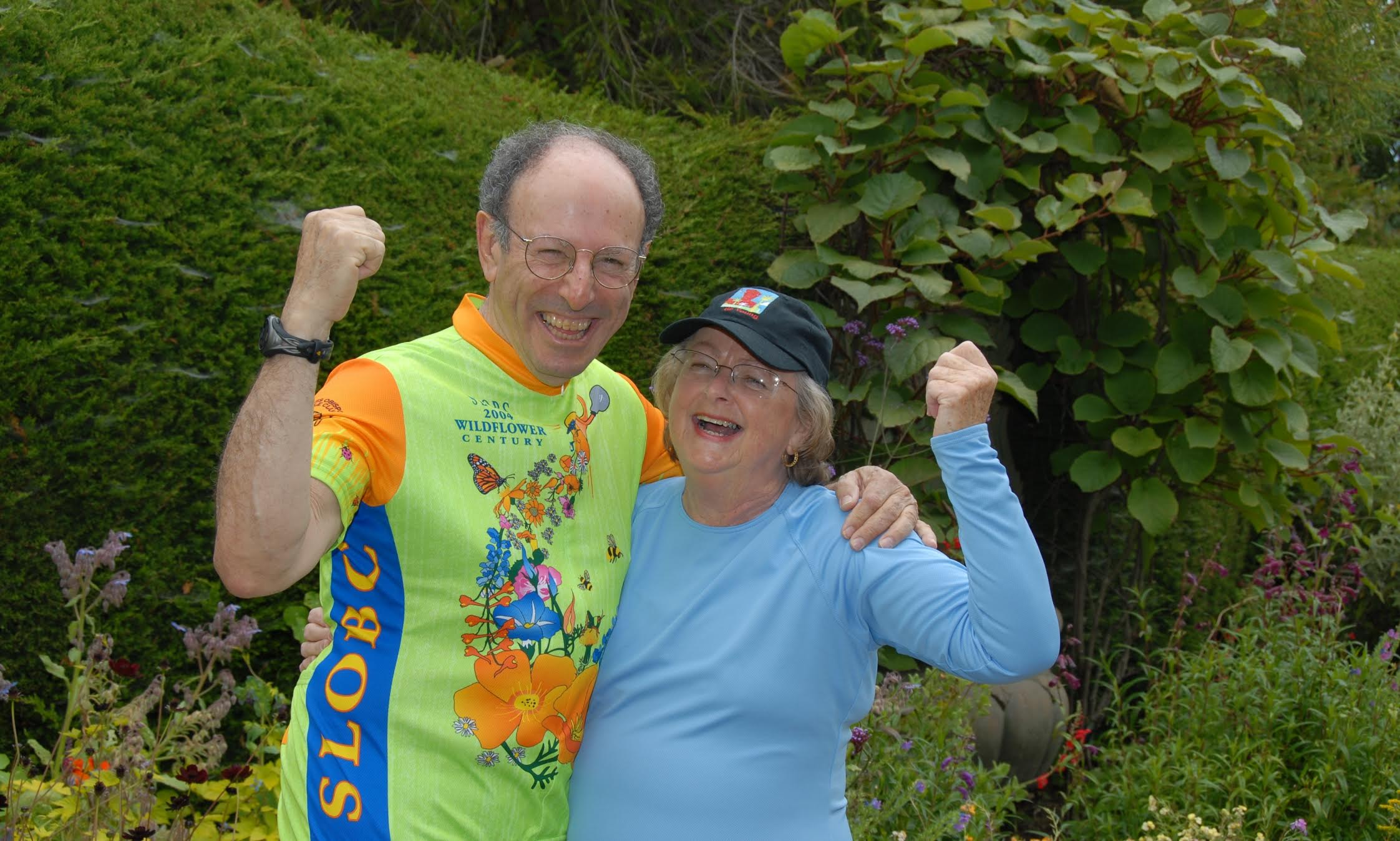 Carole (in her original GH Rashguard) and Paul (in his San Luis Obispo Bicycle Club Wildflower Century Jersey) posing for their 2004 holiday card.